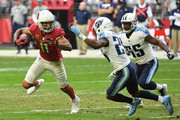 Larry Fitzgerald #11 of the Arizona Cardinals makes a reception in front of Adoree' Jackson #25 and Jayon Brown #55 of the Tennessee Titans in the second half at University of Phoenix Stadium on December 10, 2017 in Glendale, Arizona. On this play, Fitzgerald surpasses Randy Moss (15,292) for third-most all-time receiving yards.