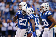 Frank Gore #23 of the Indianapolis Colts celebrates with T.Y. Hilton #13 after a touchdown against the Tennessee Titans during the first half at Lucas Oil Stadium on November 26, 2017 in Indianapolis, Indiana.