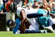 Blaine Gabbert #7 of the Tennessee Titans is sacked by Calais Campbell #93 of the Jacksonville Jaguars during their game at TIAA Bank Field on September 23, 2018 in Jacksonville, Florida.