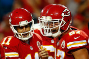 Quarterback Alex Smith #11 of the Kansas City Chiefs celebrates with tight end Travis Kelce #87 after a touchdown during the preseason game against the Tennessee Titans at Arrowhead Stadium on August 28, 2015 in Kansas City, Missouri.