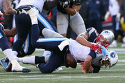 Jabaal Sheard #93 of the New England Patriots sacks Zach Mettenberger #7 of the Tennessee Titans during the first half at Gillette Stadium on December 20, 2015 in Foxboro, Massachusetts.