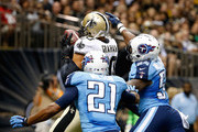 George Wilson #21 of the Tennessee Titans and Avery Williamson #54 tackle Jimmy Graham #80 of the New Orleans Saints during a preseason game at the Mercedes-Benz Superdome on August 15, 2014 in New Orleans, Louisiana.