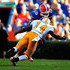 Eric Berry Photos - Tim Tebow #15 of the Florida Gators is tackled by Eric Berry #14 of the Tennessee Volunteers during the game at Ben Hill Griffin Stadium on September 19, 2009 in Gainesville, Florida. - Tennessee v Florida