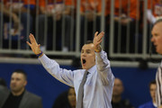 Head coach Bllly Donovan of the Florida Gators calls the play to his team during the first half against Tennessee Volunteers at Stephen C. O'Connell Center on January 25, 2014 in Gainesville, Florida.