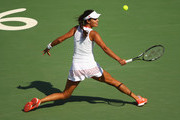 Ana Ivanovic of Serbia stretches to play a backhand against Carla Suarez Navarro of Spain in their first round match on Day 1 of the Rio 2016 Olympic Games at the Olympic Tennis Centre on August 6, 2016 in Rio de Janeiro, Brazil.
