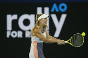 Caroline Wozniacki of Denmark plays a shot during the Rally for Relief Bushfire Appeal event at Rod Laver Arena on January 15, 2020 in Melbourne, Australia.