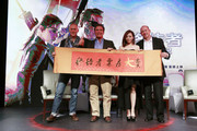 (L to R) Alan Taylor, Director, Arnold Schwarzenegger, Jane Zhang, and Rob Moore, Vice President of Paramount, pose for a picture at the press conference of Terminator Genisys on August 21, 2015 in Shanghai, China.