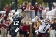 Quarterback Trevor Knight #8 of the Texas A&M Aggies throws a pass as linebacker J.T. Gray #12 of the Mississippi State Bulldogs tries to block it during the first half of an NCAA college football game at Davis Wade Stadium on November 5, 2016 in Starkville, Mississippi.