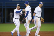 Devon Travis #29 of the Toronto Blue Jays celebrates their victory with Josh Donaldson #20 and Troy Tulowitzki #2 during MLB game action against the Texas Rangers at Rogers Centre on May 26, 2017 in Toronto, Canada.