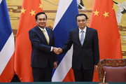 Thai Prime Minister Prayut Chan-o-cha (L) shakes hands with Chinese Premier Li Keqiang (R) during a signing ceremony at the Great Hall of the People on December 22, 2014 in Beijing, China. Prayut Chan-o-cha is on a visit to China from December 22 to 23.