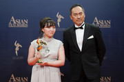 Samal Yeslyamova poses for a photograph with Japanese actor Ken Watanabe after winning the Best Actress Award at the 13th Asian Film Awards on March 17, 2019 in Hong Kong, Hong Kong.