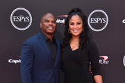 Retired football player Curtis Conway and retired boxer  Laila Ali attend The 2018 ESPYS at Microsoft Theater on July 18, 2018 in Los Angeles, California.
