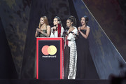 *** EDITORIAL USE ONLY IN RELATION TO THE BRIT AWARDS 2018 *** (L-R) Jesy Nelson, Perrie Edwards, Leigh Anne Pinnock and Jade Thirlwall of Little Mix present the Best British Male Solo Artist award on stage at The BRIT Awards 2018 held at The O2 Arena on February 21, 2018 in London, England.