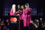 British Artist Video Of The Year winners Jesy Nelson, Leigh-Anne Pinnock, Jade Thirlwall and Perrie Edwards of Little Mix onstage during The BRIT Awards 2019 held at The O2 Arena on February 20, 2019 in London, England.