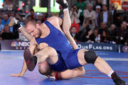 Tervel Dlagnev of the USA takes down Eduard Bazrov of Russia during the Grapple in the Apple on June 7, 2012 in Times Square in New York, New York.