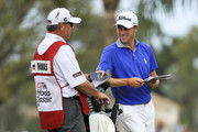 Justin Thomas and his caddie Jimmy Johnson talk on the tenth fairway during the third round of the Honda Classic at PGA National Resort and Spa on February 24, 2018 in Palm Beach Gardens, Florida.