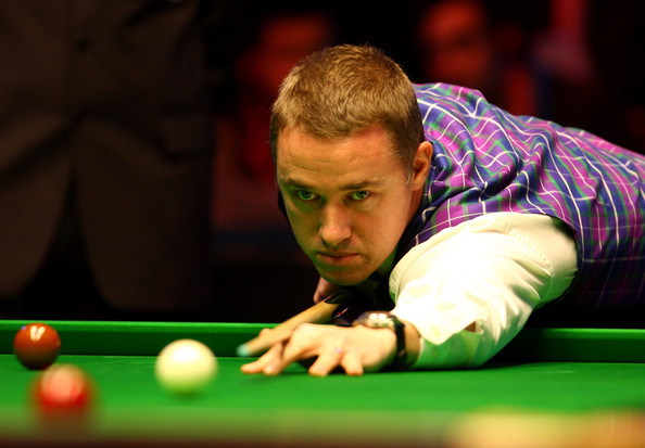 Stephen Hendry of Scotland lines up a shot in his second round match against Shaun Murphy of England during the PokerStar.com Masters snooker tournament at Wembley Arena on January 11, 2010 in London, England.