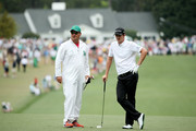 Justin Rose of England and caddie Mark Fulcher on the first hole during the final round of the 2013 Masters Tournament at Augusta National Golf Club on April 14, 2013 in Augusta, Georgia.