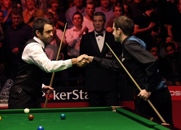 Ronnie O'Sullivan of England (L) shakes his opponents hand before the last  frame in the final against Mark Selby of England during the PokerStars.com Masters at Wembley Arena on January 17, 2010 in London, England.