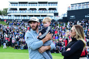 Dustin Johnson of the United States talks to his partner Paulina Gretzky and son Tatum Gretzky Johnson during a practice round prior to the start of the 2017 Masters Tournament at Augusta National Golf Club on April 3, 2017 in Augusta, Georgia.  (Photo by Harry How/Getty Images) *** Local Caption *** Tatum Gretzky Johnson; Paulina Gretzky; Dustin Johnson