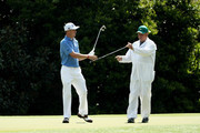 Justin Thomas of the United States changes clubs with caddie Jimmy Johnson during a practice round prior to the start of the 2018 Masters Tournament at Augusta National Golf Club on April 3, 2018 in Augusta, Georgia.