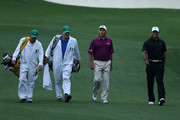 (L-R) Caddie David Kerr, caddie Joe LaCava, Fred Couples and Tiger Woods walk up the fairway during a practice round prior to the start of the 2012 Masters Tournament at Augusta National Golf Club on April 3, 2012 in Augusta, Georgia.
