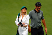 Dustin Johnson of the United States and Paulina Gretzky attend the Par 3 Contest prior to the start of the 2016 Masters Tournament at Augusta National Golf Club on April 6, 2016 in Augusta, Georgia.