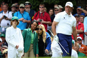 Phil Mickelson of the United States is watched by wife Amy, son Evan and Former United States Secretary of State Condoleezza Rice during the Par 3 Contest prior to the start of the 2016 Masters Tournament at Augusta National Golf Club on April 6, 2016 in Augusta, Georgia.