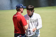 Webb Simpson of the United States talks with Bubba Watson of the United States during the Par Three Contest prior to the start of the 2014 Masters Tournament at Augusta National Golf Club on April 9, 2014 in Augusta, Georgia.