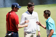 Webb Simpson of the United States, Bubba Watson of the United States and Rickie Fowler of the United States shake hands during a practice round prior to the start of the 2014 Masters Tournament at Augusta National Golf Club on April 9, 2014 in Augusta, Georgia.