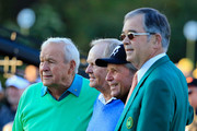Honorary starters Arnold Palmer, Jack Nicklaus and Gary Player pose with William Porter Payne, chairman of Augusta National Golf Club, on the first tee at the start of the first round of the 2014 Masters Tournament at Augusta National Golf Club on April 10, 2014 in Augusta, Georgia.