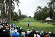 Rory McIlroy of Northern Ireland plays his third shot on the tenth green  during the third round of the 2018 Masters Tournament at Augusta National Golf Club on April 7, 2018 in Augusta, Georgia.