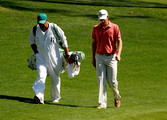 Justin Rose of England (R) walks with caddie Mark Fulcher (L) on the 15th hole during the third round of the 2012 Masters Tournament at Augusta National Golf Club on April 7, 2012 in Augusta, Georgia.