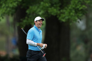 Rory McIlroy of Northern Ireland reacts to a shot from a bunker on the fifth hole  during the third round of the 2018 Masters Tournament at Augusta National Golf Club on April 7, 2018 in Augusta, Georgia.