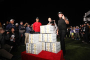 Phil Mickelson celebrates with the winnings after defeating Tiger Woods as Ernie Johnson looks on during The Match: Tiger vs Phil at Shadow Creek Golf Course on November 23, 2018 in Las Vegas, Nevada.
