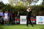 Phil Mickelson plays his shot from the second tee as Tiger Woods looks on during The Match: Tiger vs Phil at Shadow Creek Golf Course on November 23, 2018 in Las Vegas, Nevada.