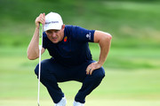 Justin Rose of England lines up a putt on the 12th green during the final round of The Northern Trust at Liberty National Golf Club on August 11, 2019 in Jersey City, New Jersey.