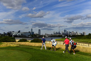Brandt Snedeker of the United States and Jon Rahm of Spain walk on the 18th hole during the final round of The Northern Trust at Liberty National Golf Club on August 11, 2019 in Jersey City, New Jersey.