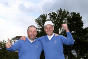 Damien McGrane and David Higgins celebrate after the the singles matches on the final day of the 28th PGA Cup at Foxhills Golf Course on September 17, 2017 in Ottershaw, England.