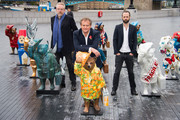 (L-R) Michael Howells, Hugh Bonneville and Ryan McElhinney attend the launch of The Paddington Trail at The Scoop, More London on November 3, 2014 in London, England.