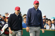 Jordan Spieth and Dustin Johnson of the United States Team walk off the third tee during the Saturday foursomes matches at The Presidents Cup at Jack Nicklaus Golf Club Korea on October 10, 2015 in Songdo IBD, Incheon City, South Korea.