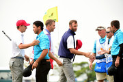 Dustin Johnson and Jordan Spieth of the United States Team defeat Jason Day and Charl Schwartzel of the International Team 1up during the Saturday foursomes matches at The Presidents Cup at Jack Nicklaus Golf Club Korea on October 10, 2015 in Songdo IBD, Incheon City, South Korea.