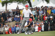 (L-R) Jordan Spieth and Dustin Johnson of the United States Team look over the 18th green during the Saturday foursomes matches at The Presidents Cup at Jack Nicklaus Golf Club Korea on October 10, 2015 in Songdo IBD, Incheon City, South Korea.
