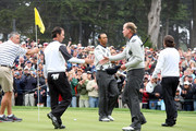 Tiger Woods and Mike Weir Photos Photo