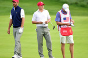 Jordan Spieth and Dustin Johnson of the United States Team wait in the seventh fairway during the Saturday foursomes matches at The Presidents Cup at Jack Nicklaus Golf Club Korea on October 10, 2015 in Songdo IBD, Incheon City, South Korea.