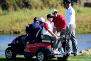 Jordan Spieth and Dustin Johnson of the United States Team ride a golf cart on the 18th hole during the Friday four-ball matches at The Presidents Cup at Jack Nicklaus Golf Club Korea on October 9, 2015 in Songdo IBD, Incheon City, South Korea