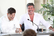 Louis Tomlinson and Simon Cowell laugh during The X Factor 2018 launch at Somerset House on July 17, 2018 in London, England.