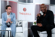 Executive Editor, TheWrap, Tim Molloy (L) and Writer/Director/Producer, John Singleton speak onstage at TheWrap's 8th Annual TheGrill at Montage Beverly Hills on October 2, 2017 in Beverly Hills, California.