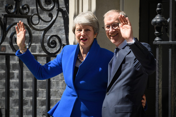 News Pictures Of The Week - July 25 [the week,news pictures,blue,cobalt blue,electric blue,suit,event,formal wear,glasses,eyewear,white-collar worker,gesture,theresa may,philip,boris johnson,prime minister,doorstep,address,british,conservative party]