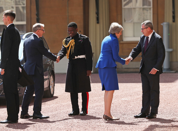 Queen Receives Outgoing And Incoming Prime Ministers [uniform,standing,event,official,gesture,suit,white-collar worker,tourism,theresa may,queen,philip may,prime ministers,edward young,prime minister,monarch,number,palace,major]